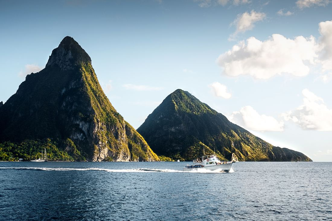 Boat passing in front of the Pitons in Saint Lucia